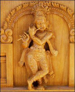 486px-Krishna_holding_flute