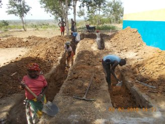 Bore villagers digging foundations