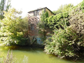 Decaying building beside the river