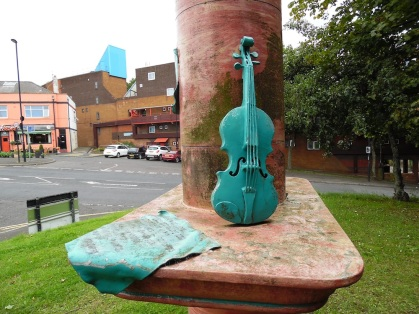 Violin and plaque with view