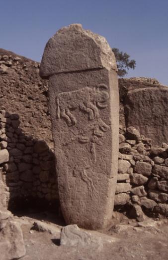Gobekli Tepe pillar with a bull, fox, and crane